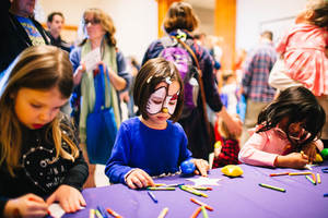 Young girls participate in Family Day colouring acitivities at the  Minneapolis Institute of Art. Photo credit:  @MinneapolisInstituteofArts on Flickr.